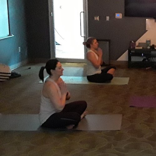 Two women in a yoga pose